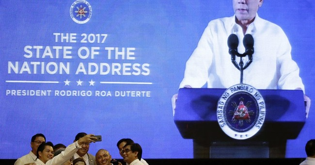 Duterte vows end to uprising, 'jail or hell' in drug war
