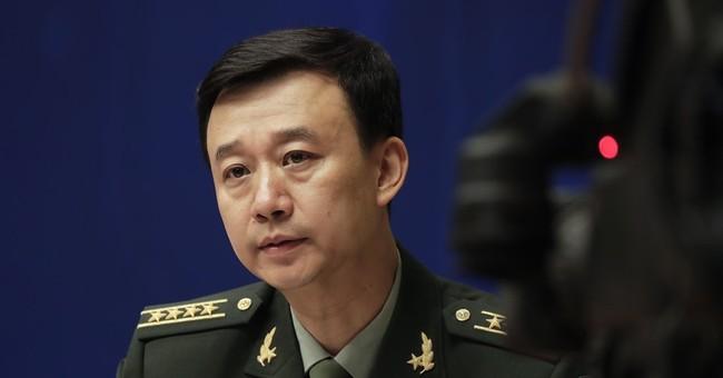 China warns India of its 'resolve' amid border standoff