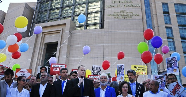 Turkish opposition journalists on trial for aiding 'terror'
