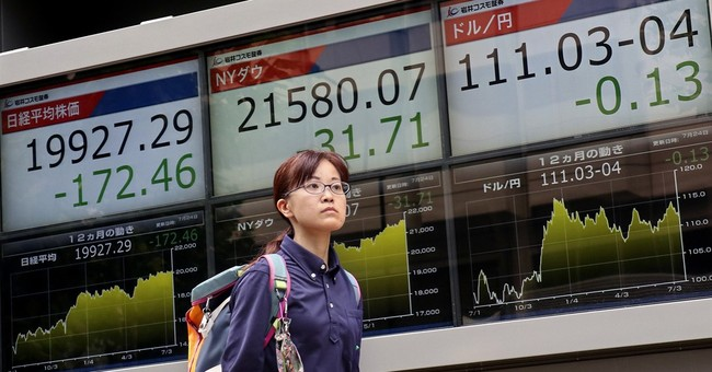 Global shares mixed as attention turns to Fed meeting