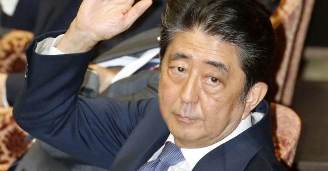 Japan's Abe denies abusing influence in favoritism scandal