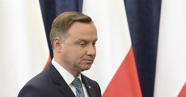 The Latest: Poles push president to veto final judicial bill