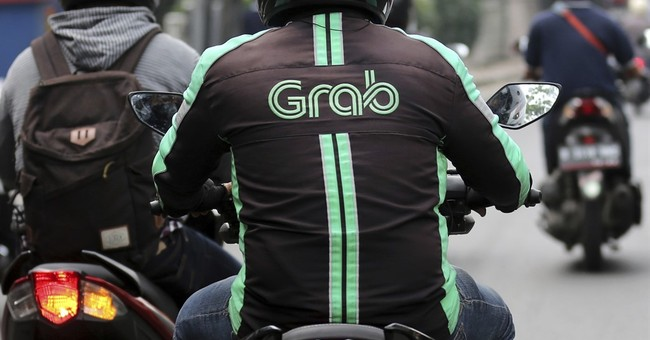 Grab builds out war chest in a fight for car-share dominance