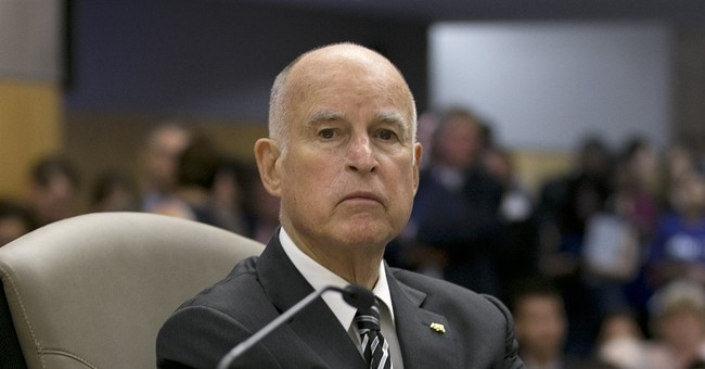 The Latest: California governor signs climate change bill