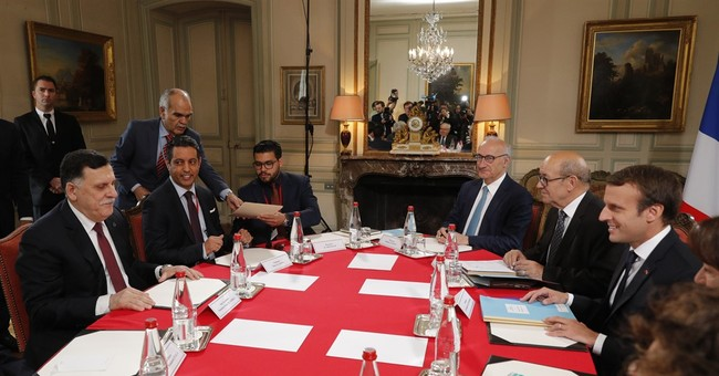 Libyan rivals agree in France to cease-fire, elections