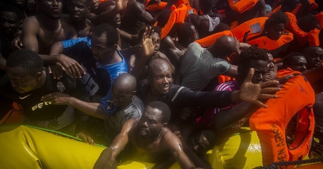The Latest: 13 dead migrants found on boat in Mediterranean