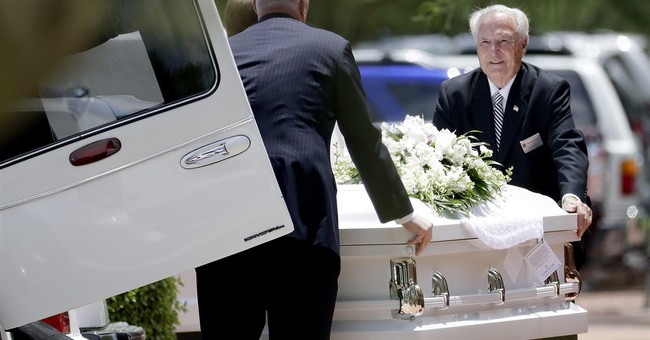 10 white caskets and memories: Funeral honors flood victims