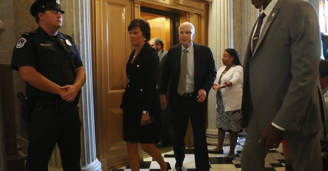 McCain delivers a key health care vote, scolding message