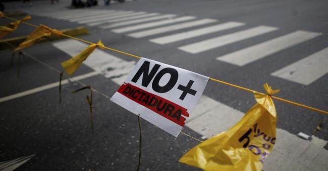 The Latest: Man slain at protest in western Venezuela