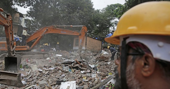 Death toll in building collapse in India rises to 17