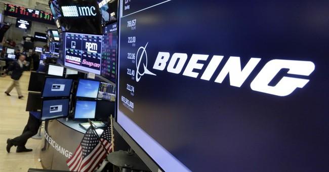 Boeing beats 2Q profit forecasts, raises full-year outlook