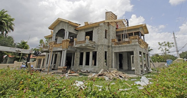 New-home sales improved modestly in June