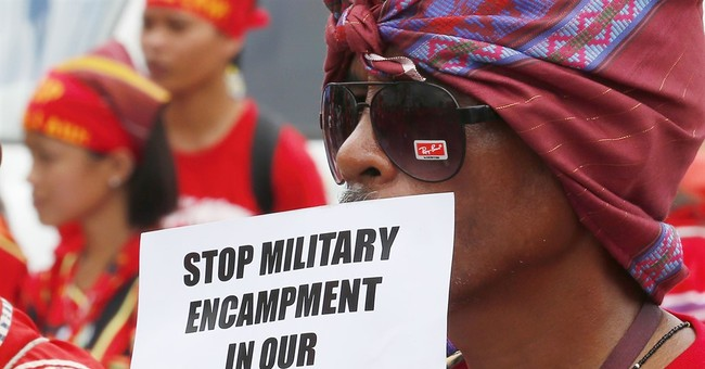 Rights groups ask Duterte to retract threat to bomb schools