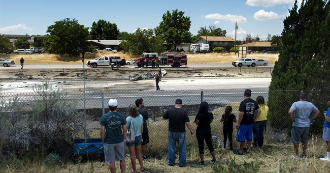 The Latest: Plane crash kills 2 couples leaving on vacation