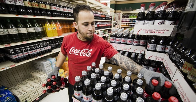 Coca-Cola's 2Q profit hurt by charge, but still tops Street
