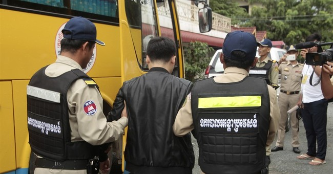 Cambodia deports telephone fraud suspects to China