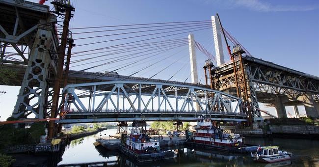 Bridge on a barge: Old span dismantled, shipped down creek