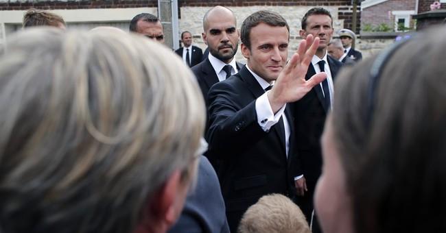 French president attends memorial for IS-slain priest
