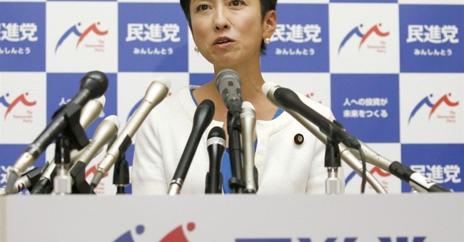 Japan opposition head quits as PM Abe suffers scandal