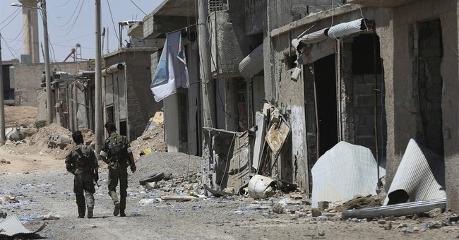 US-backed Syrian fighters now control almost half of IS city