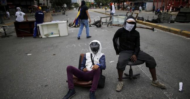 Deaths in Venezuela unrest hit 102 as polarizing vote nears