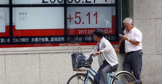 World stocks mixed amid raft of corporate earnings