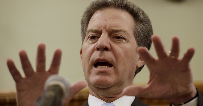 Kansas' Brownback still touts tax cuts as he heads to exit