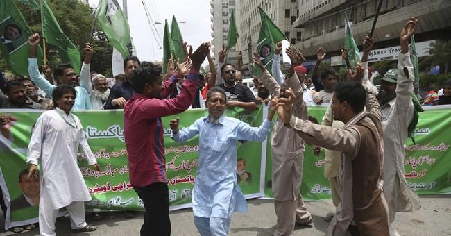 The Latest: Pakistan's Imran Khan hails PM disqualification