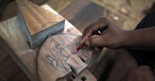 Nepal woodcarvers inspired to restore quake-toppled temples