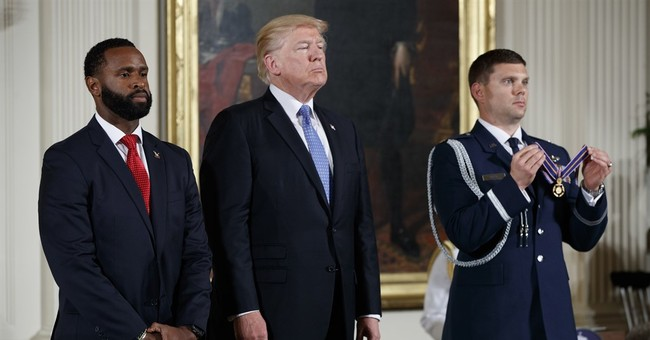 The Latest: Trump says 'let Obamacare implode'
