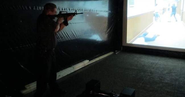 In shooting simulator, fairgoers aim from police perspective