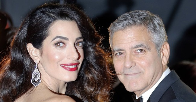 George Clooney threatens prosecution over pics of baby twins