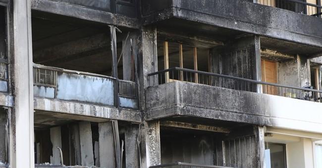 APNewsBreak: Honolulu high-rise had outdated fire alarms