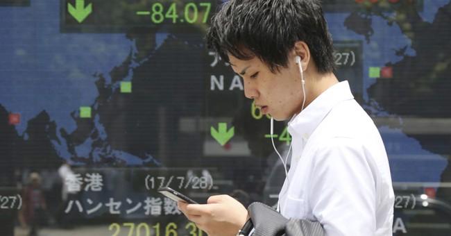 Stock markets slide as tech earnings underwhelm
