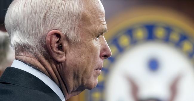 McCain returns to Arizona for cancer treatment