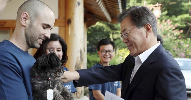 South Korean leader adopts dog saved from possible slaughter