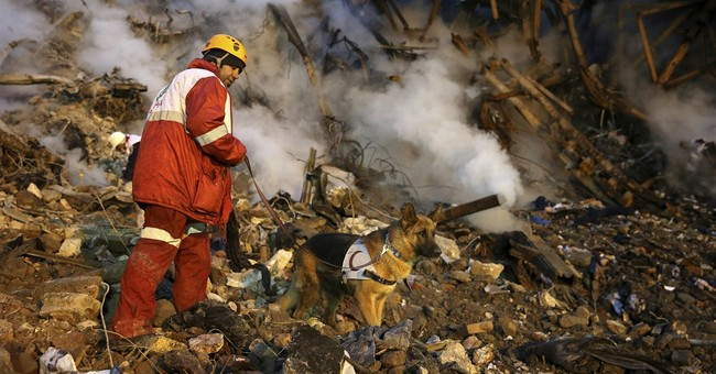 Rescue teams pull 2 bodies from Iran building rubble