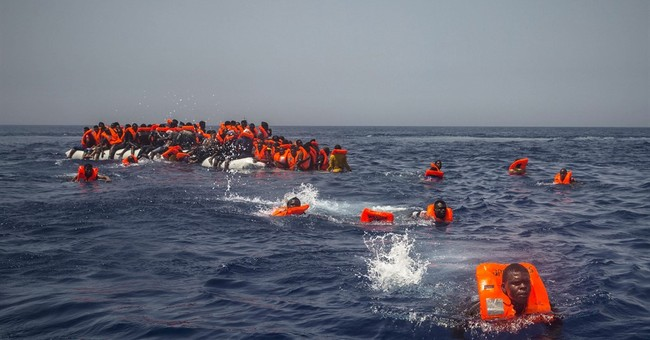 The Latest: Flotilla departs to counter anti-migrant boat
