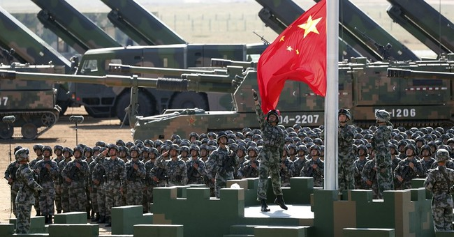 Chinese president oversees military parade in show of might