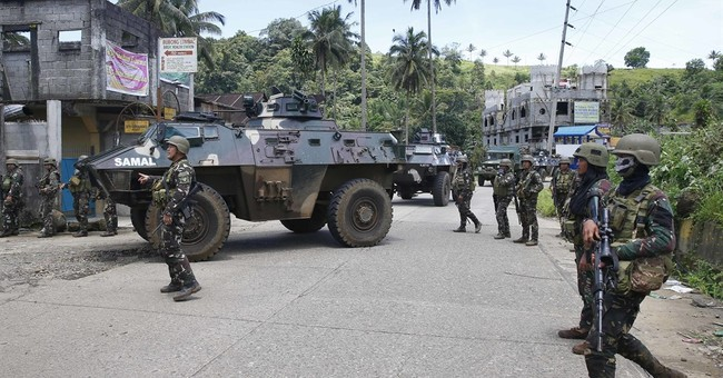 Philippine troops capture key bridge near Marawi militants