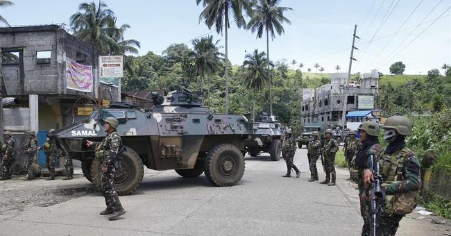 Philippine troops capture key bridge near Marawi militants