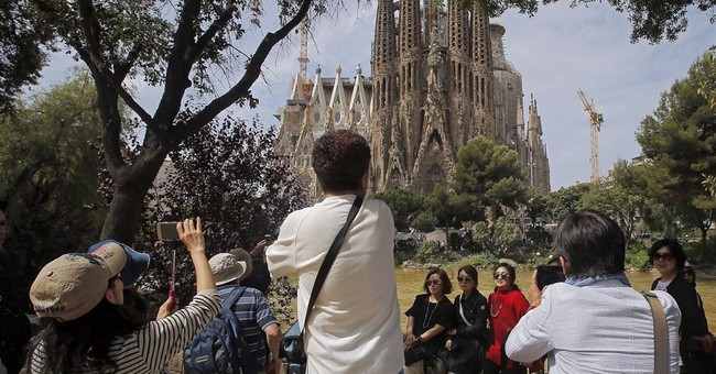 Spain's tourist numbers up a record 12 percent in first half