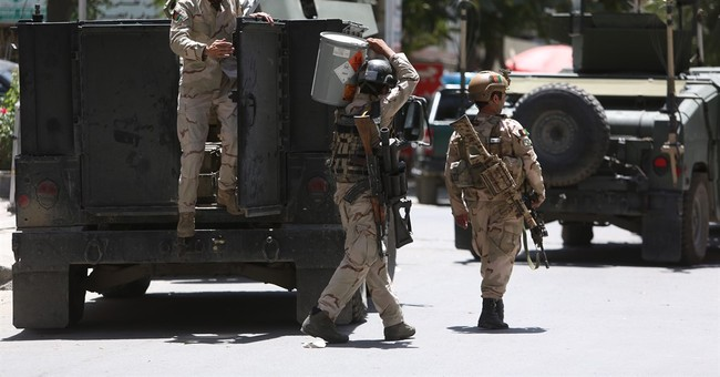 The Latest: Afghanistan says 2 Iraq embassy staff killed