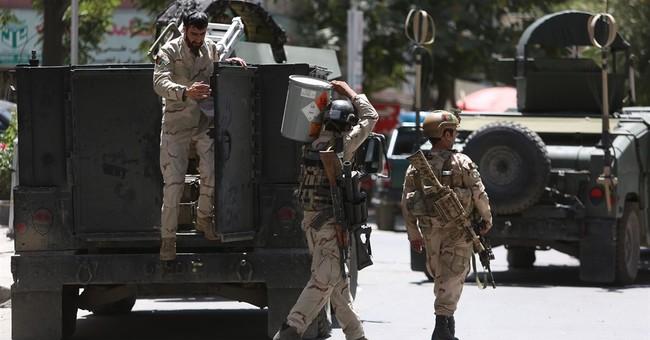 The Latest: Afghanistan says 2 Iraq embassy staff killed
