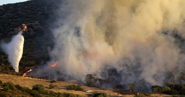 Greek authorities battle big wildfire south of Athens