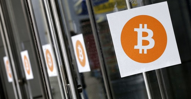AP Explains: Threat of a bitcoin split avoided, for now