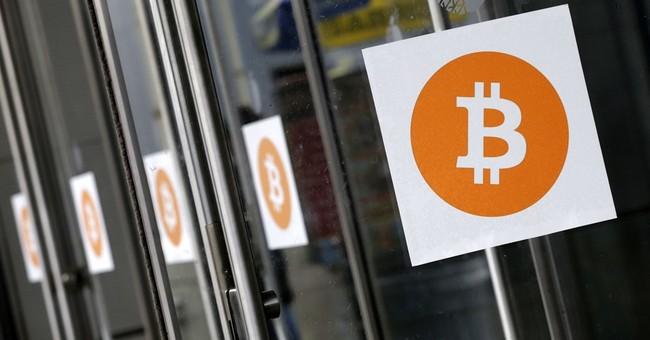 AP Explains: Threat of a bitcoin split avoided, for now