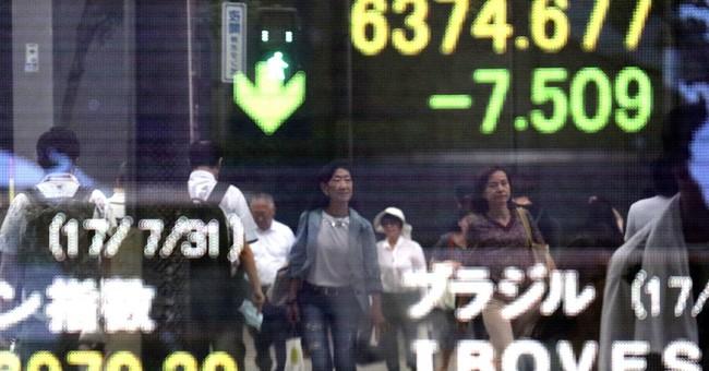 Global stocks mostly rise as investors eye earnings