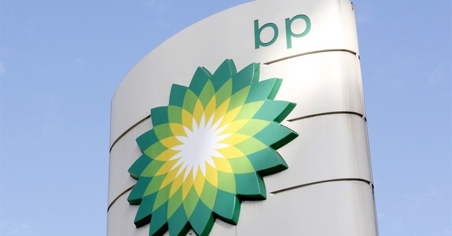 BP sees earnings slip as spill costs continue to weigh