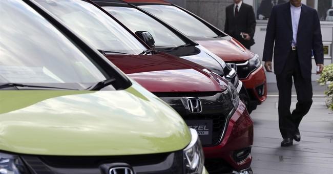 Honda reports 19 percent rise in profit on sales, cost cuts